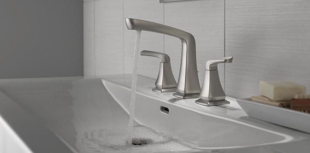 side view of Delta Vesna 8 in. Widespread 2-Handle Bathroom Faucet in SpotShield Brushed Nickel with water flowing out of faucet