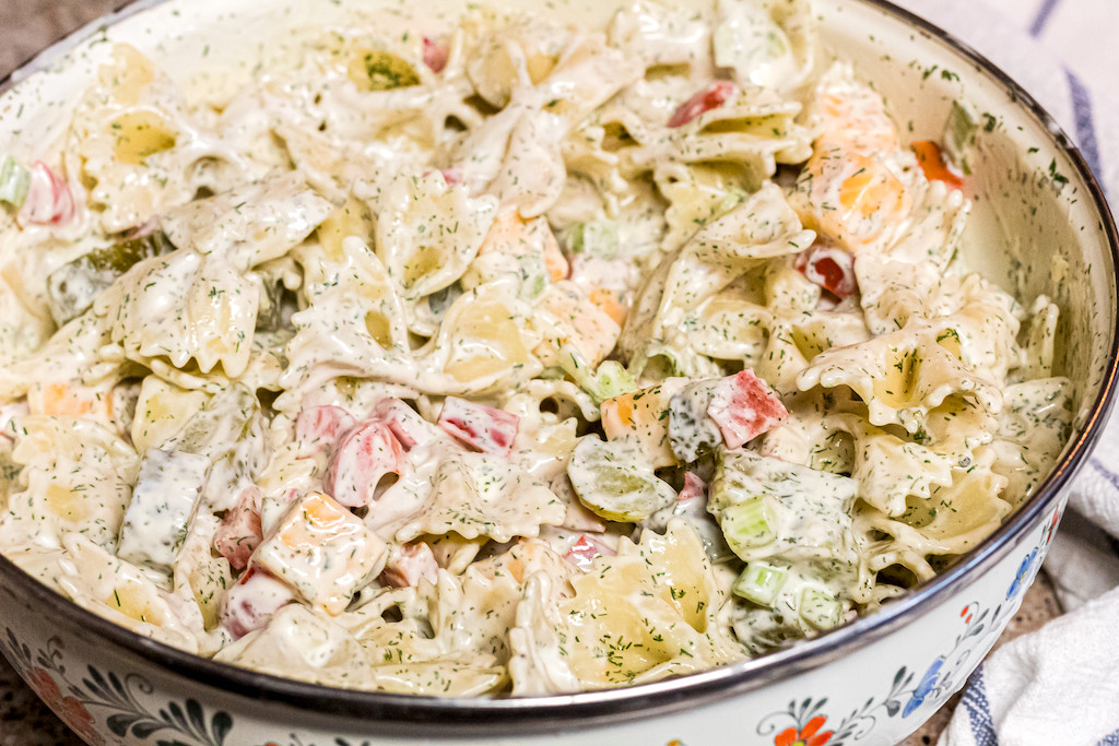 dill pickle pasta salad in large serving bowl