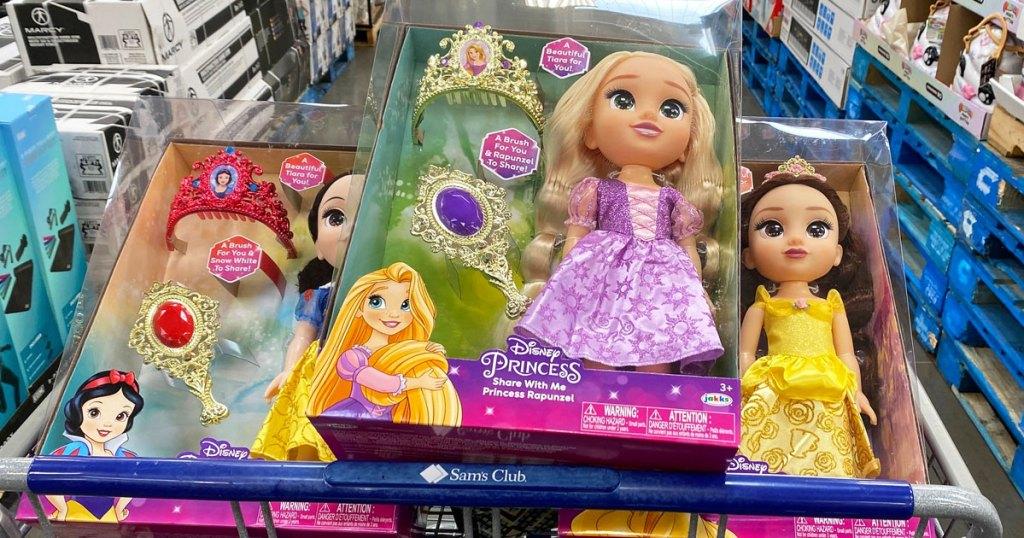 rapunzel, snow white, and belle disney princess dolls in sam's club shopping cart
