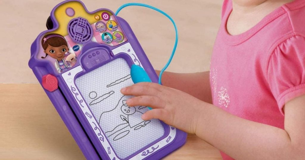 girl playing on electronic clipboard