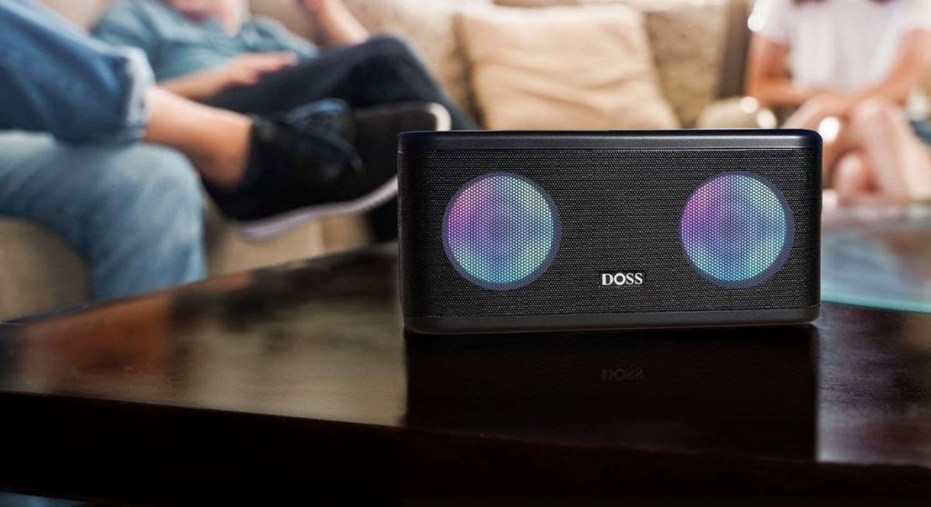 small speaker with lights on a coffee table