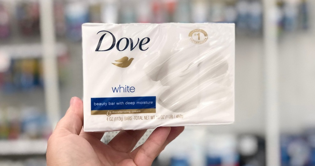 person holding up a white and blue box of Dove Beauty Bars