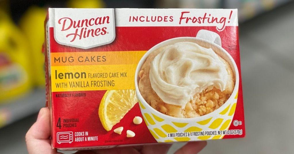 hand holding a box of Duncan Hines Mug Cake Lemon