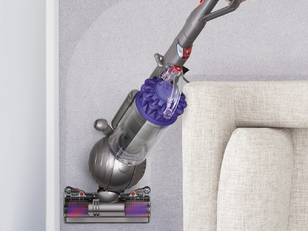 dyson ball vacuum being pushed around the couch
