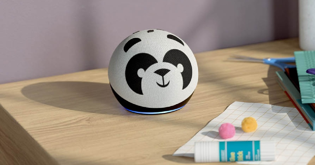 panda designed smart speaker on table with paper and glue stick