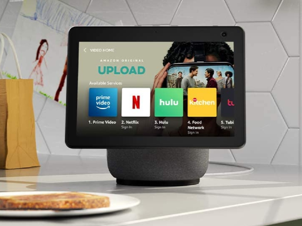 black smart display on kicthen counter and plate of taost