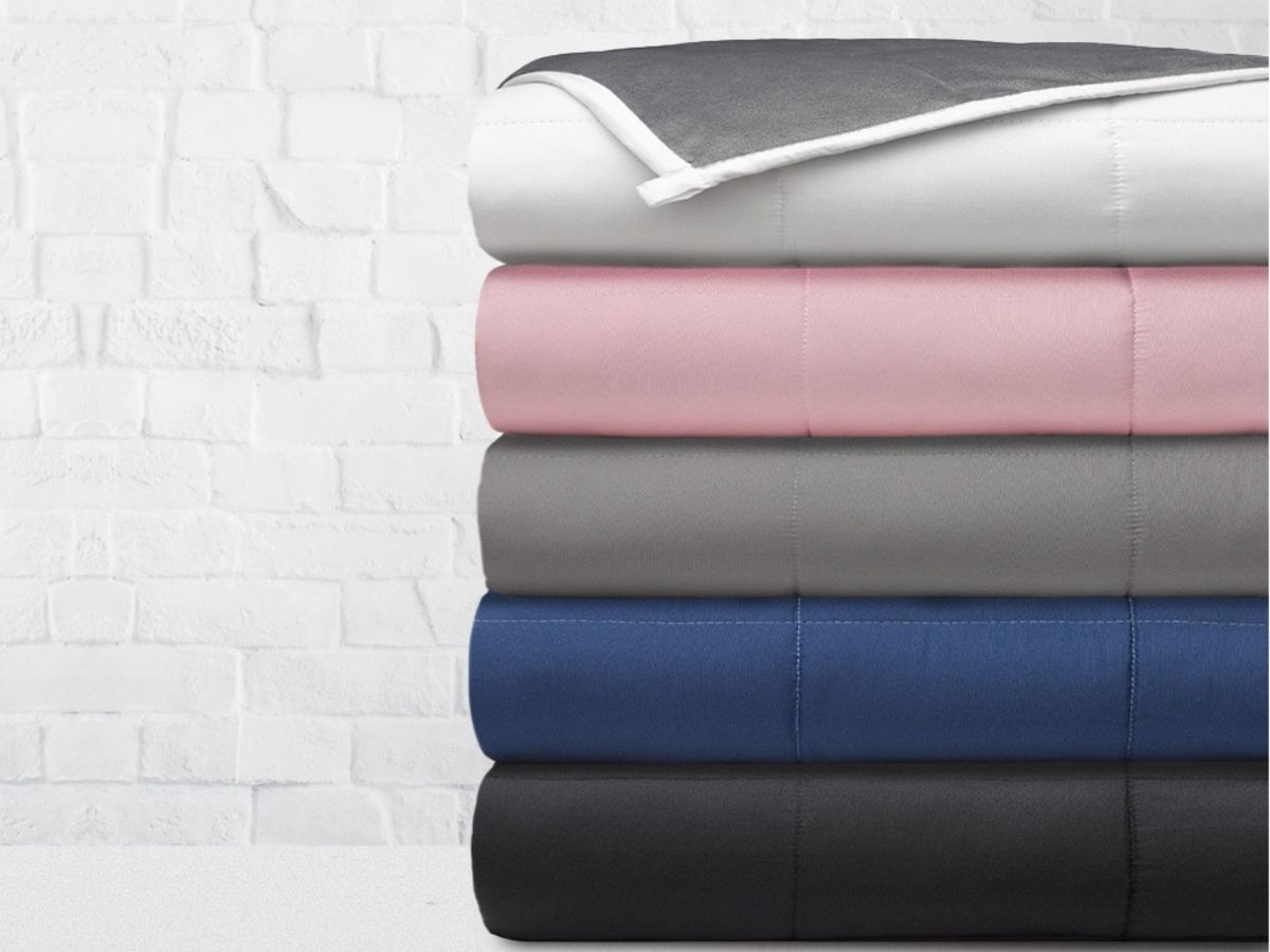 Stack of five weighted blankets