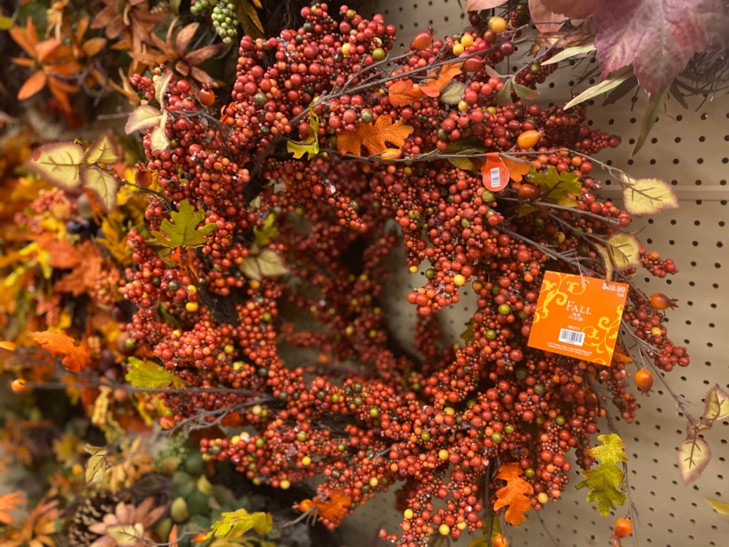 fall berry wreath hanging in store