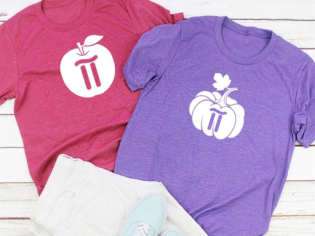 pink graphic tee, purple graphic tee, white pants, and light blue sneakers