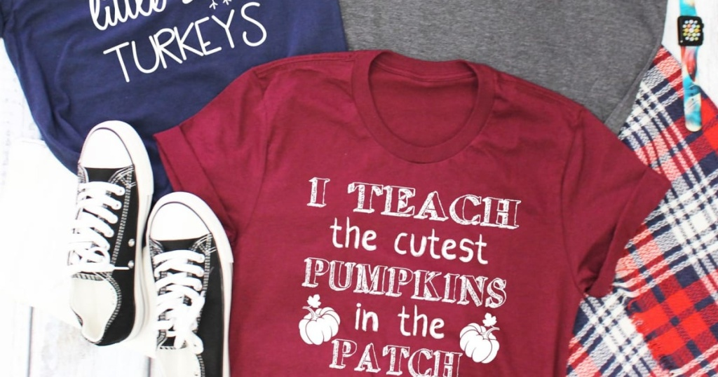 sneakers, blue graphic tee, dark pink graphic tee, and gray tee