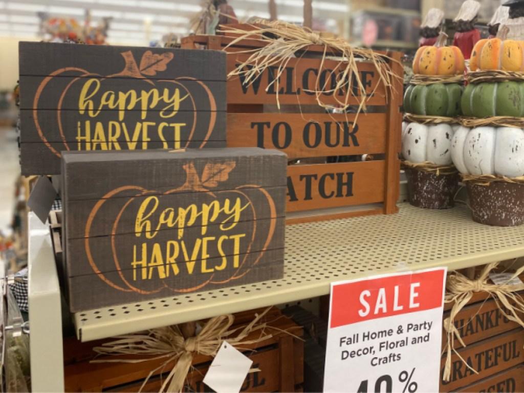 Fall themed wood wall decor on store shelf