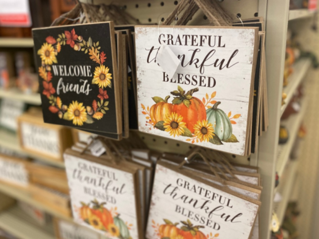 Fall themed wood wall decor hanging in store