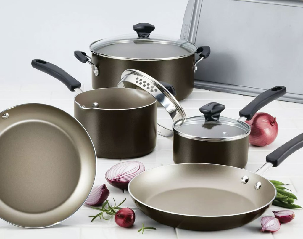 black cookware set with pots, frying pans, matching lids, and baking sheet