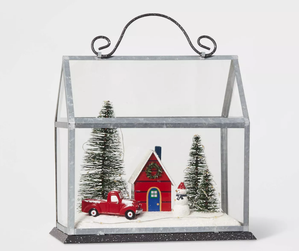 glass cloche featuring farmhouse in snow with old truck