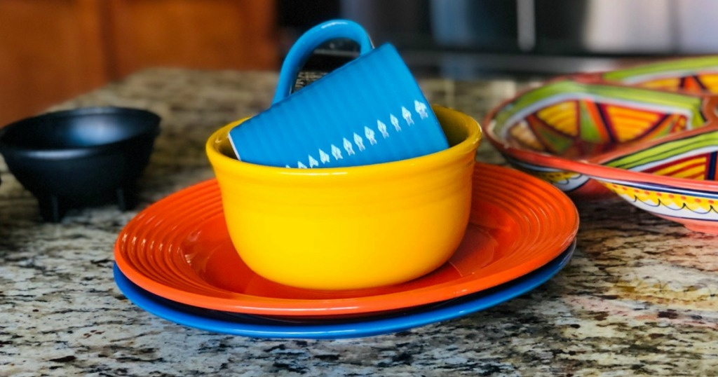 Brightly colored dinnerware on a counter top