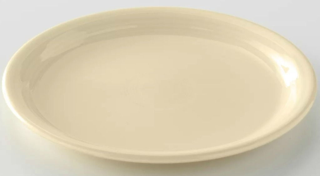 Ivory colored platter on a white surface
