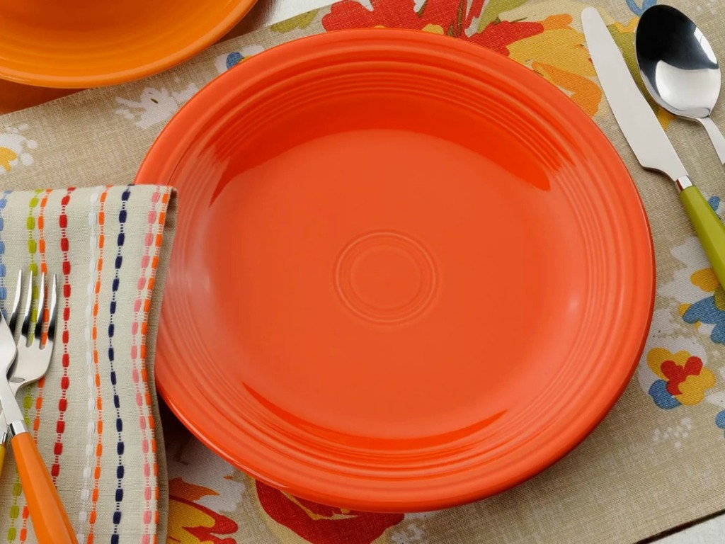 Large orange dinner plate on a table top