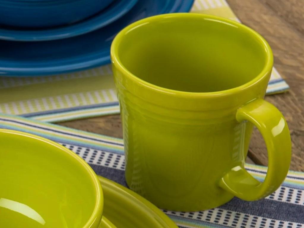 Lime green mug near matching dinnerware