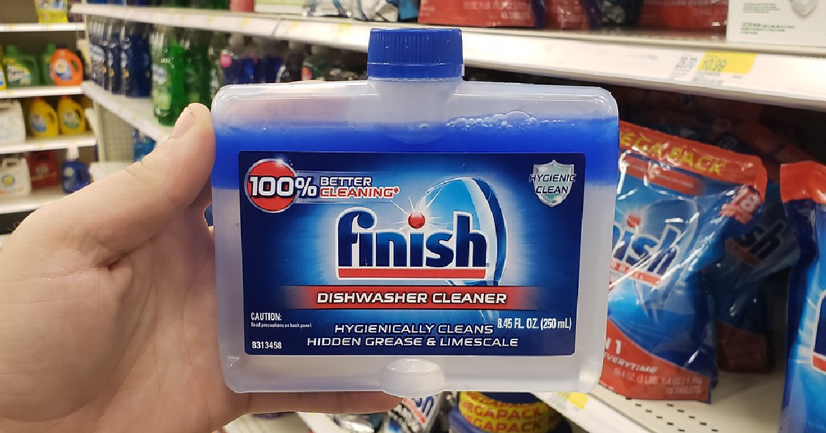 hand holding a bottle of finish dishwasher cleaner in store
