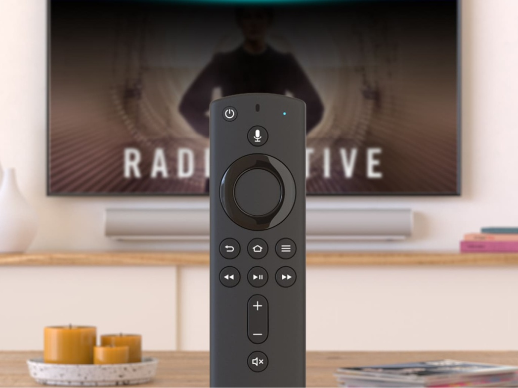 black voice control remote, tv, candles on table