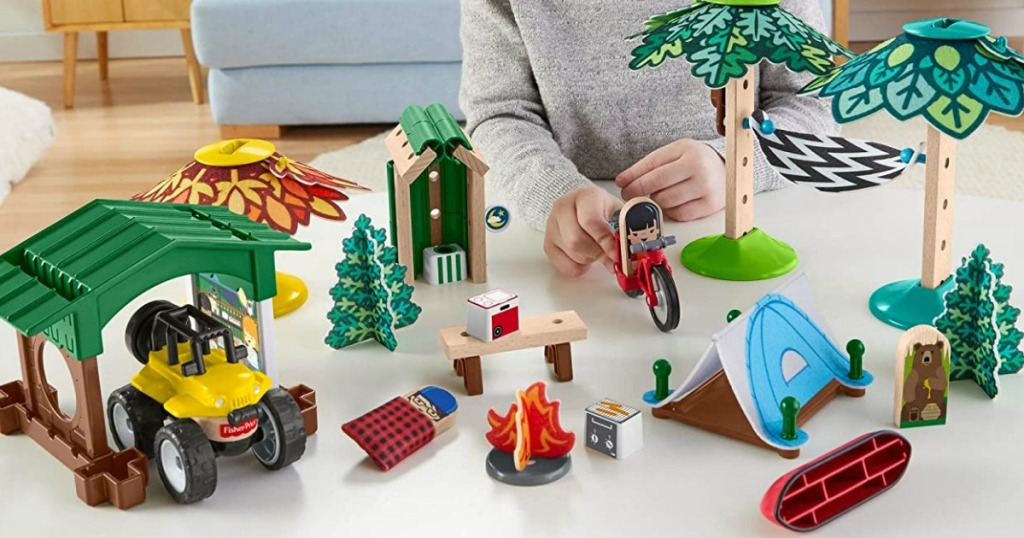 toddler playing with Fisher-Price play set