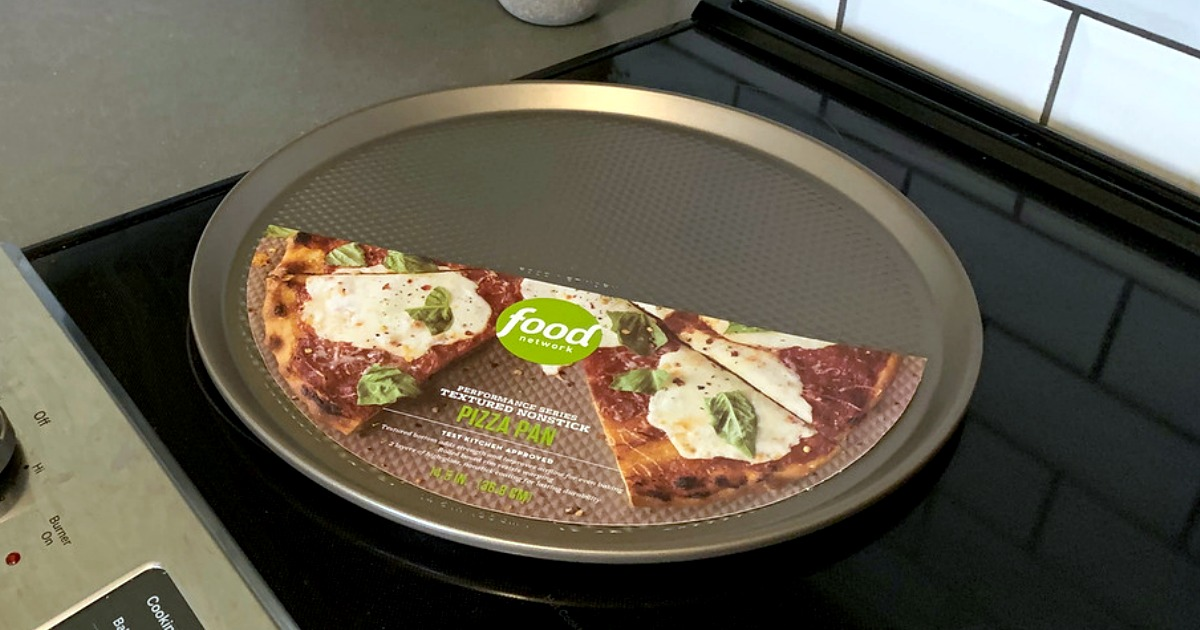 Bronze colored pizza pan on an electric stove-top