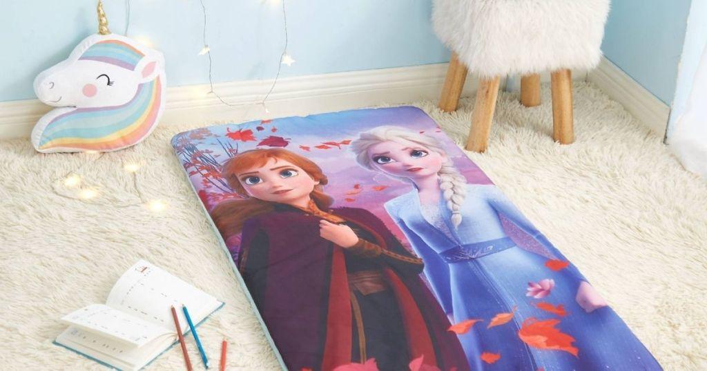 bedroom with Frozen sleeping bag, unicorn pillow and nightstand
