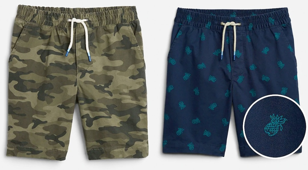 two pairs of boys shorts in camo print and pineapple print