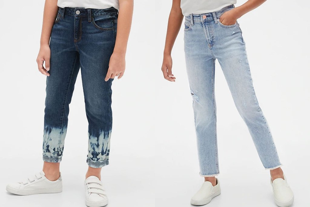 two girls modeling jeans in dark and light wash colors