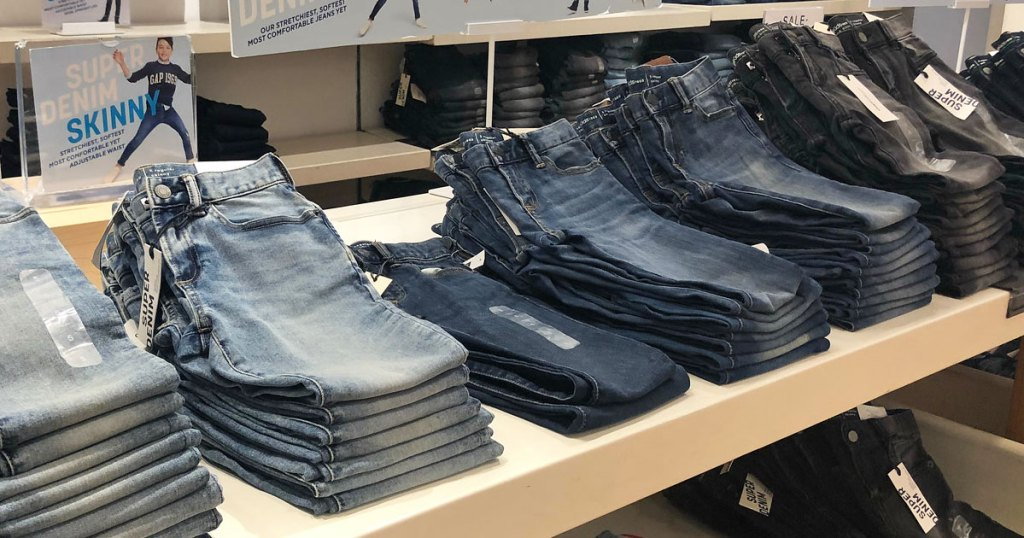 store display table full of different washes of kids jeans