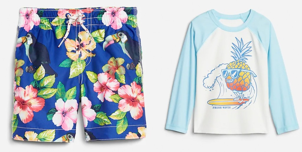 pair of blue and pink tropical print toddler swim trunks and blue and white rash guard