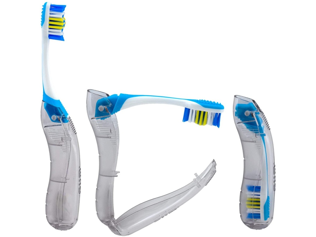 three blue and clear folding toothbrushes