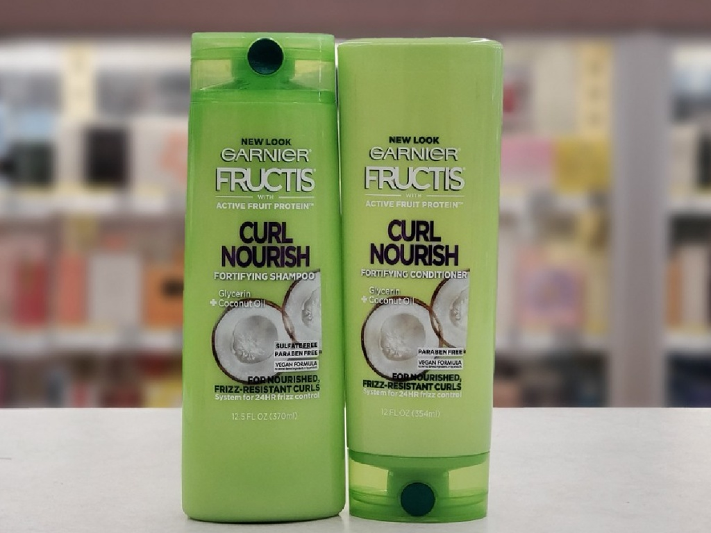 bottle of shampoo and bottle of conditioner on a counter in a store