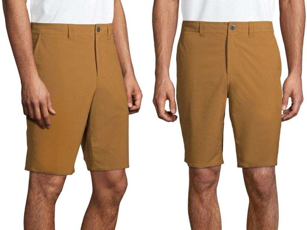 man wearing dark khaki colored shorts