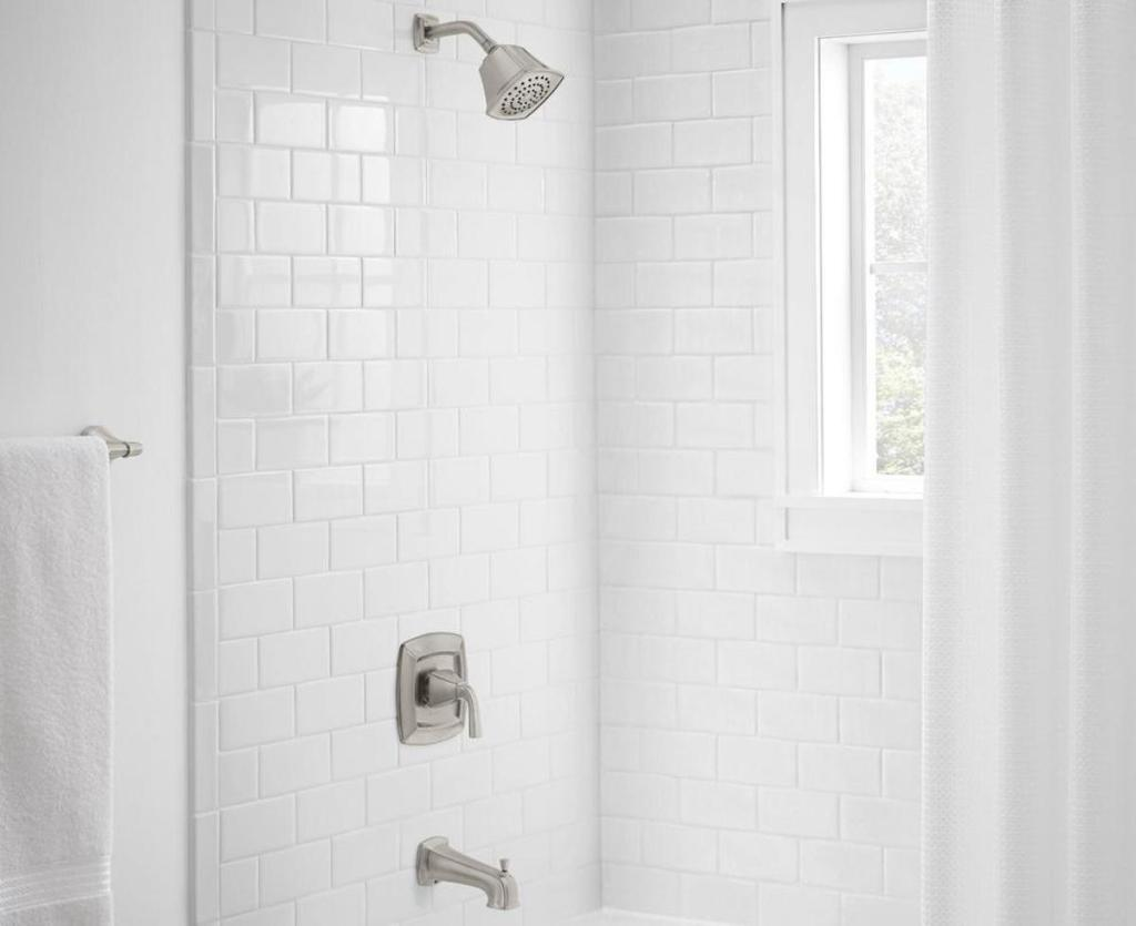 view of white shower with Glacier Bay Mason Single-Handle 1-Spray Tub and Shower Faucet in Brushed Nickel