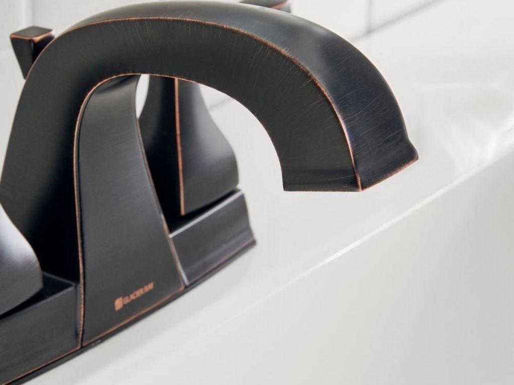 close up of Glacier Bay Milner 4 in. Centerset 2-Handle High-Arc Bathroom Faucet in Bronze
