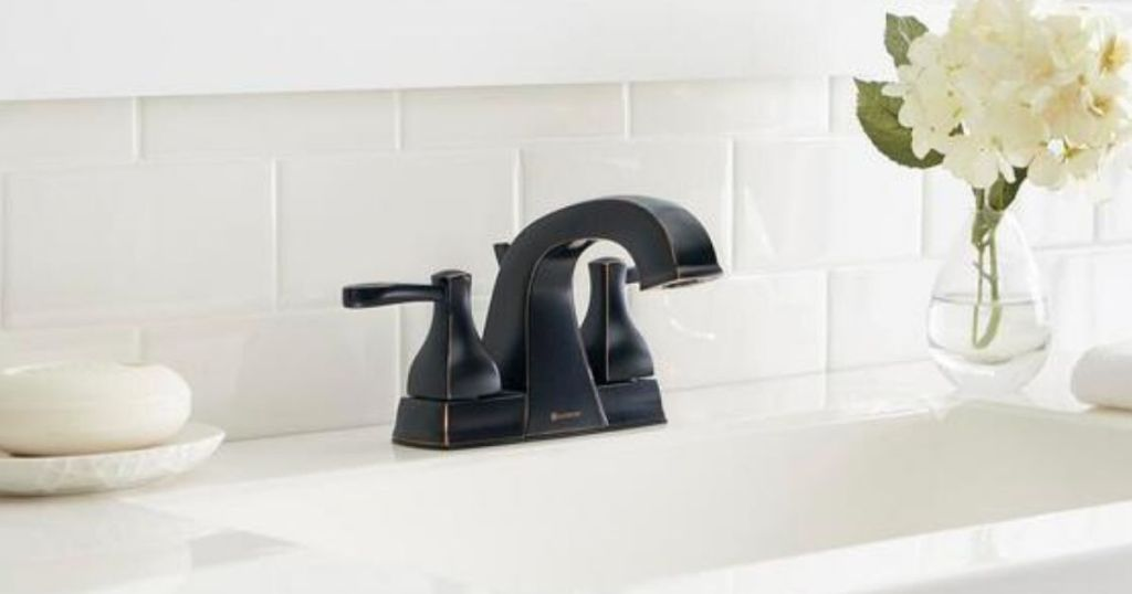Glacier Bay Milner 4 in. Centerset 2-Handle High-Arc Bathroom Faucet in Bronze on white counters