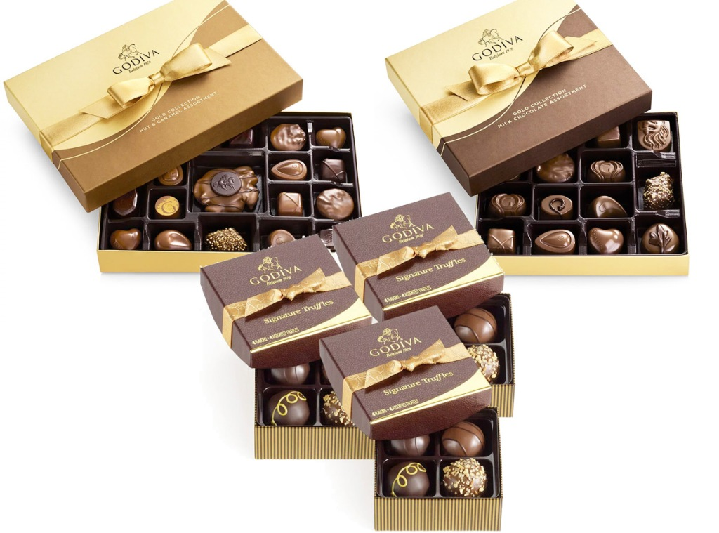two large boxes of godvia chocolates and three smaller boxes