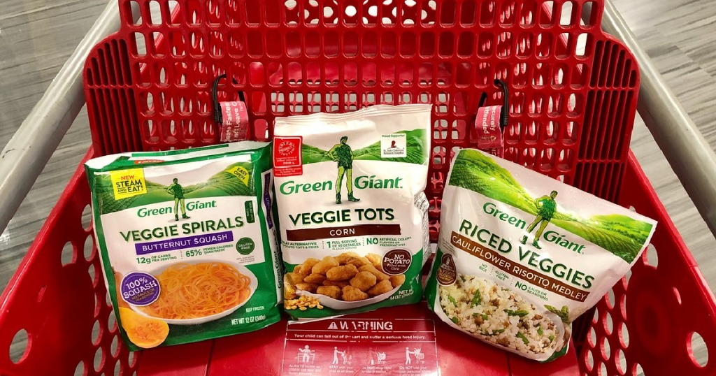 three bags of frozen veggie products in red store cart