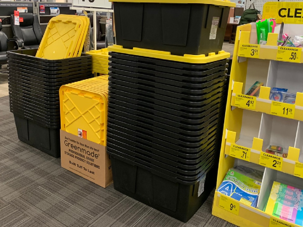 large black and yellow storage totes stacked in store