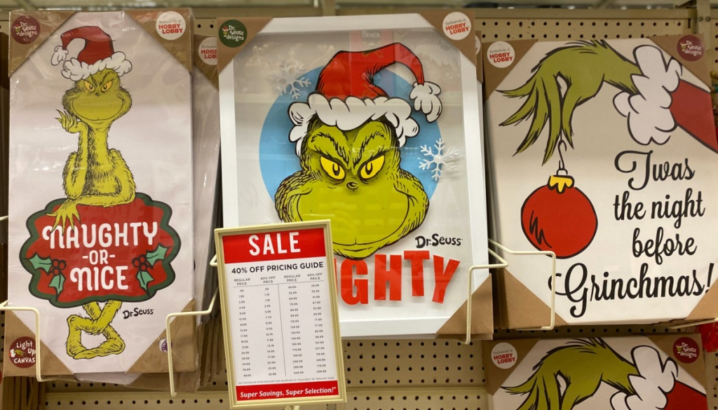 three Grinch wall decor in store