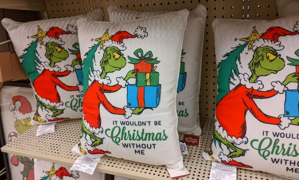 Grinch Christmas pillows on store shelf