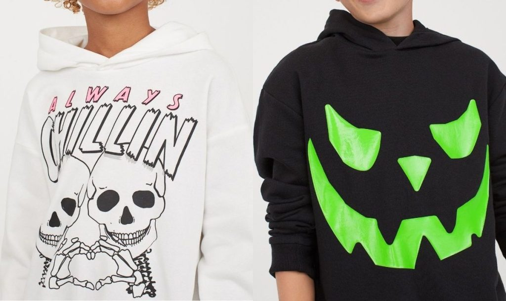 two kids wearing halloween print hoodies