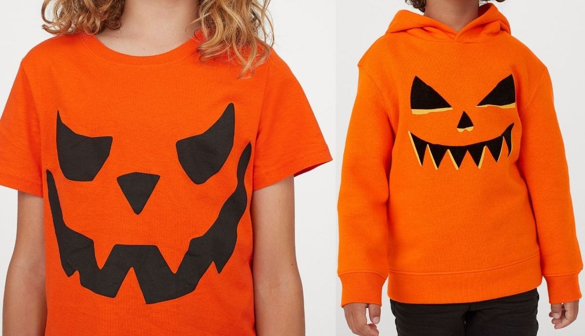 kids wearing pumpkin shirt and hoodie