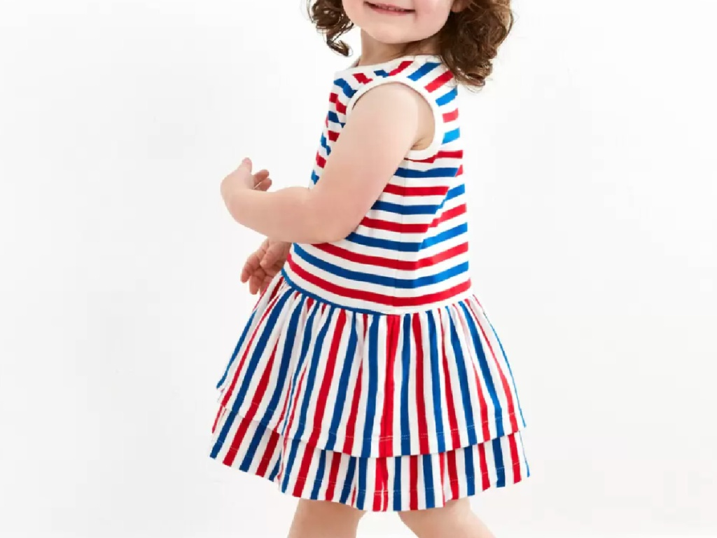 little girl wearing a red, white and blue ruffle dress