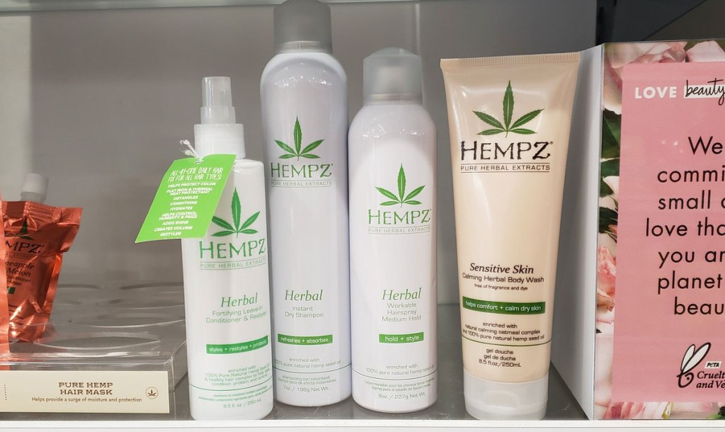 white bottles of hempz hair styling products on shelf