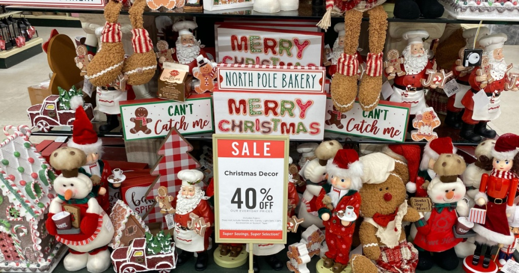 various Christmas decor and items with sale sign on store display table