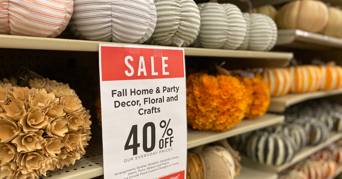 Decorative pumpkins on shelf in-store near 40% off sale sign