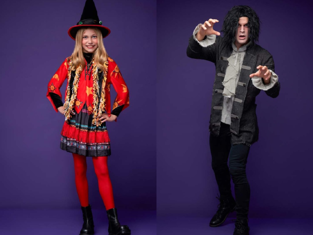 girl in red witch costume and man in black 1700s style costume