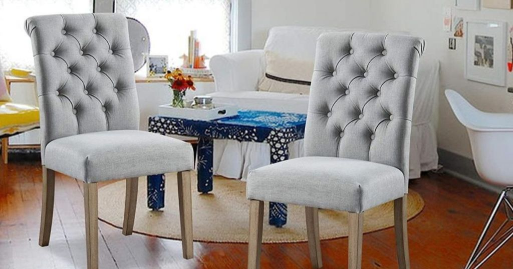 2 gray tufted chairs in living room